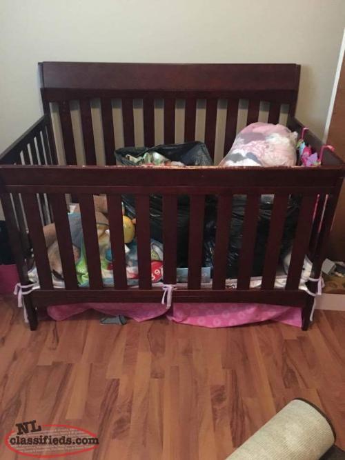 Dark brown wooden crib and matching change tabke torbay Dark wood baby furniture