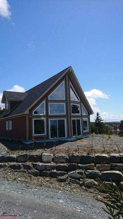 Chalet style house green 39 s harbour newfoundland for Chalet style homes for sale