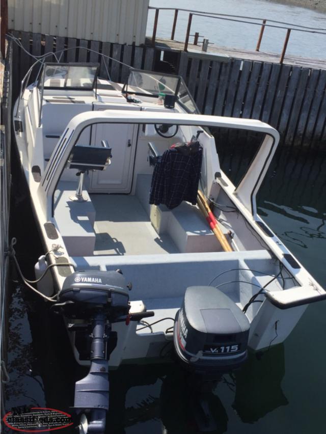 22' Sea Serpent, kicker motor, trailer and 115 HP Yamaha motor